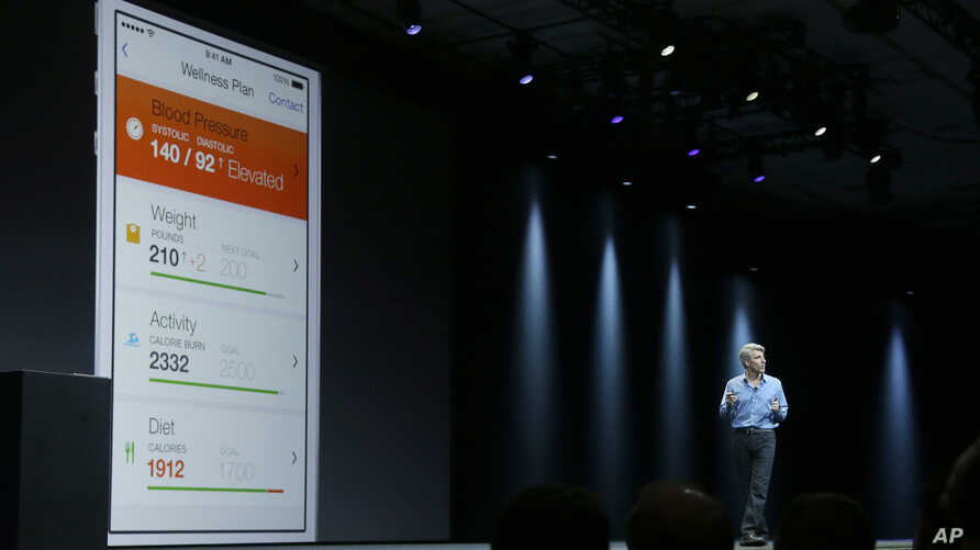 FILE - Apple senior vice president of Software Engineering Craig Federighi speaks about the Apple HealthKit app at the Apple Worldwide Developers Conference in San Francisco, June 2, 2014.