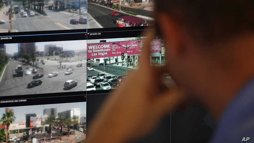 FILE - In this May 23, 2017, photo, an official watches security cameras at the Southern Nevada Counterterrorism Center in Las Vegas.