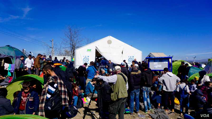 Refugees line up at the refugee entrance into Macedonia at Idomeni, Greece. Only 100 or so -- sometimes fewer -- are being allowed to cross each day.