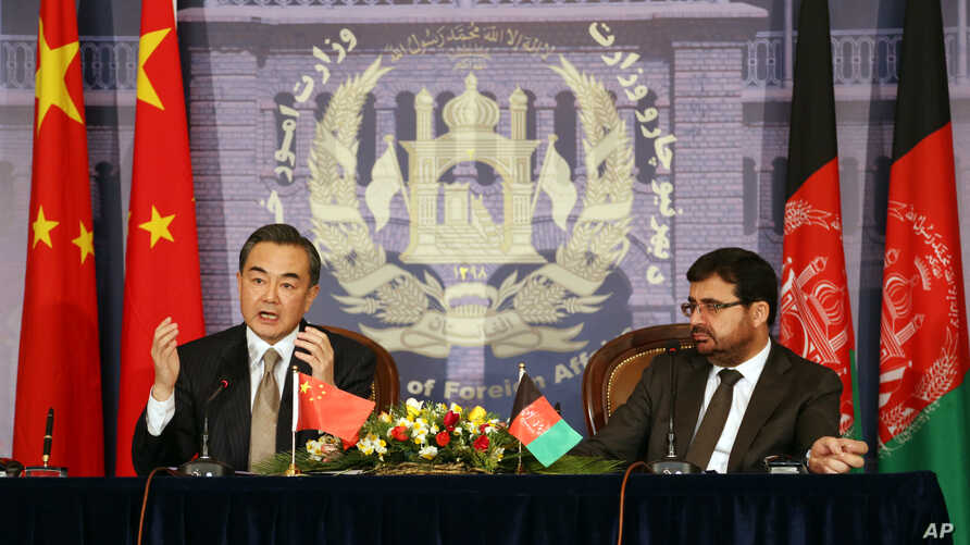 Chinese Foreign Minister Wang Yi, left, speaks during a press conference with his Afghan counterpart Zarar Ahmad Osmani at the foreign ministry in Kabul, Afghanistan, Feb. 22, 2014.