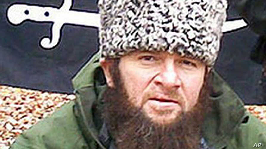 FILE -  In this screen shot taken in Moscow shows an undated photo of a man identified as Chechen separatist leader Doku Umarov,  posted on the Kavkazcenter.com site.