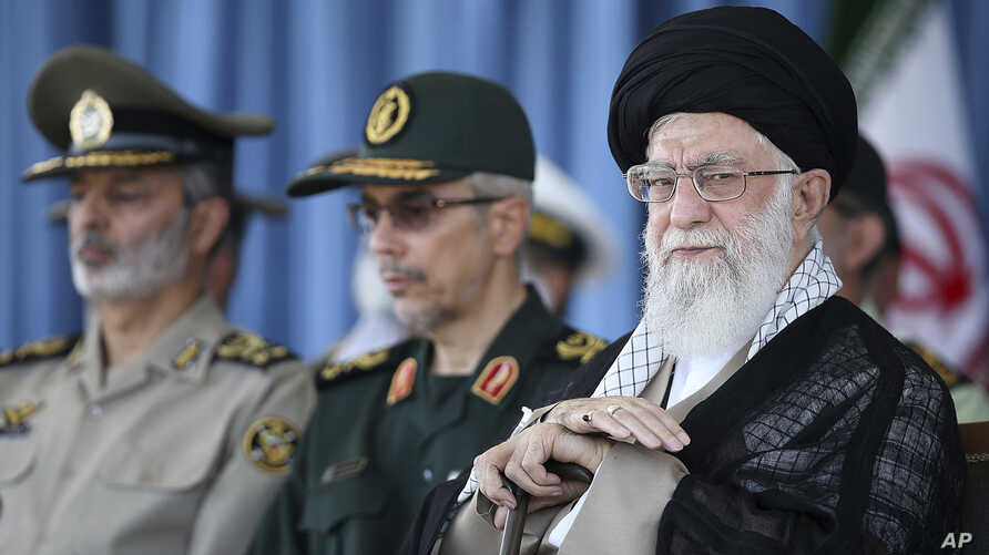 In this picture released by an official website of the office of the Iranian supreme leader, Ayatollah Ali Khamenei attends a ceremony in a military academy, in Tehran, June 30, 2018. Khamenei has accused the United States and allies of fomenting unr