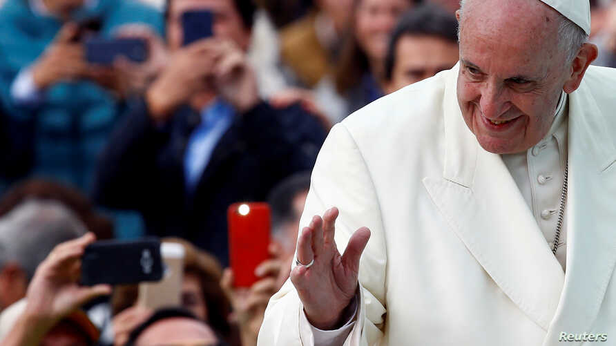 Pope Francis waves to the crowd as he arrives for a holy mass at Simon Bolivar park in Bogota, Colombia, Sept. 7, 2017.