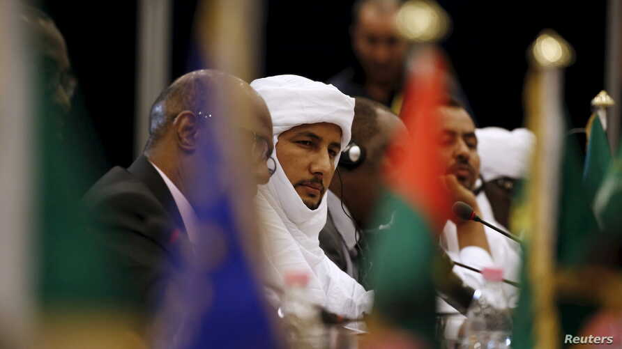 FILE - Bilal Agh Cherif (C), secretary general of The Coordination of the Movements of Azawad (CMA), attends the peace talk meeting in Algiers, Algeria, Jan. 18, 2016. Mali's government and Tuareg-led rebels held talks in Algiers on Monday aimed at a