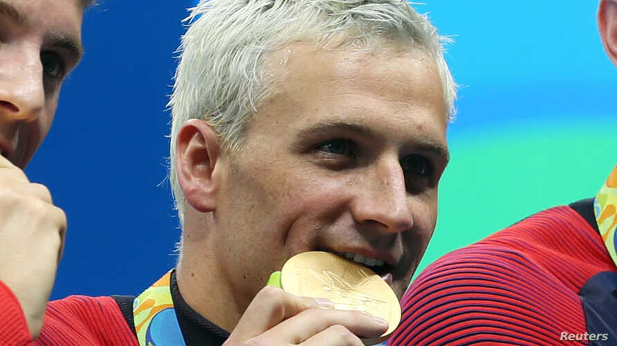 Ryan Lochte (USA) with his gold medal