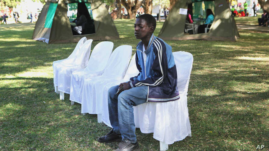 Tonderai Kanyere waits for his results after he was tested for HIV and Aids in Harare, June, 22, 2012.