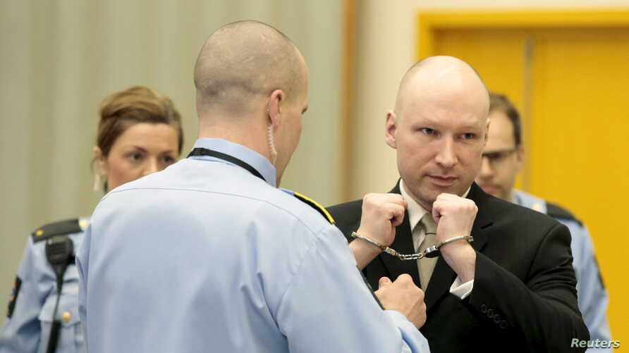 Mass killer Anders Behring Breivik has his handcuffs removed inside the court room in Skien prison, Norway, March 16, 2016.