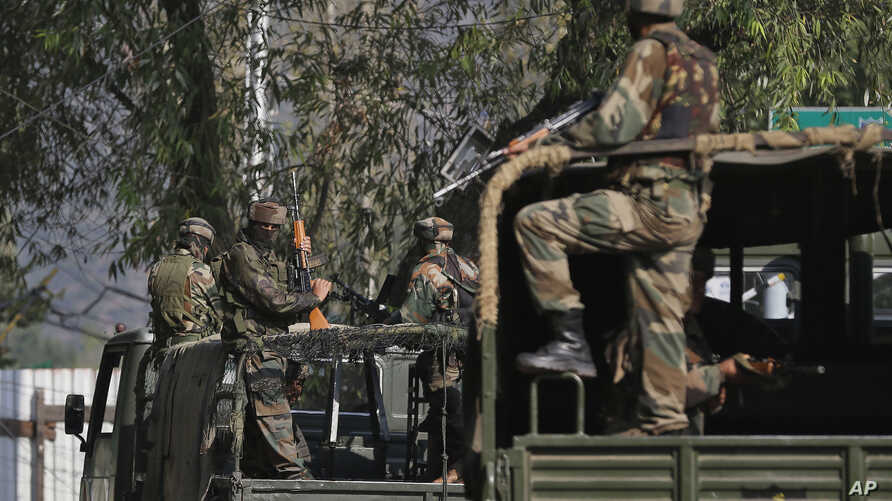 Indian soldiers guard outside the army base which was attacked Sunday by suspected militants at Uri, Indian controlled Kashmir, Sept. 19, 2016.