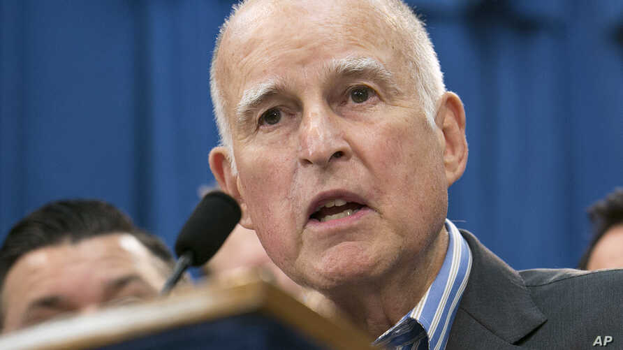FILE - Gov. Jerry Brown speaks at a Capitol news conference in Sacramento, Calif., July 17, 2017.  On Oct. 5, 2017, Brown signed sanctuary state legislation extending protections for immigrants living in the United States illegally.