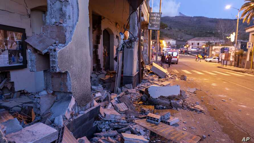 Debris of a partially collapsed house sit on the street in Fleri, Sicily, Dec. 26, 2018.
