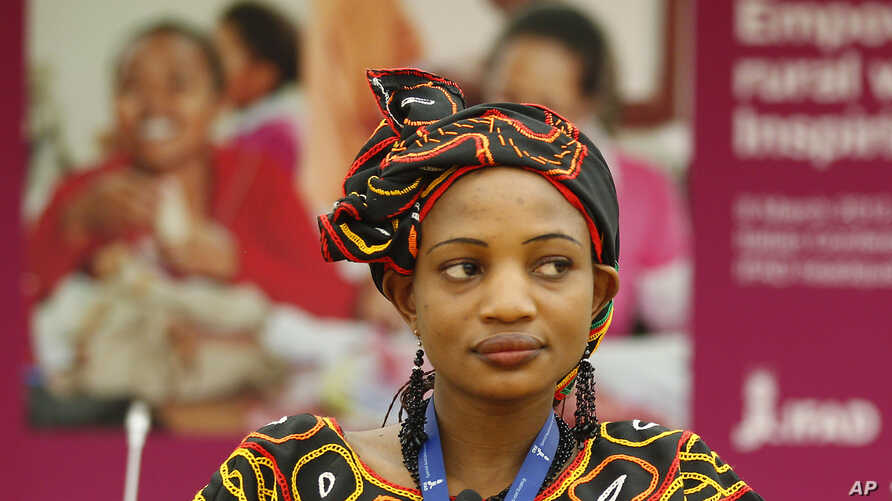 FILE - Yvette Azane Ngwemetoh, of Cameroon, a representative of rural women attends a meeting on occasion of the International Women's Day.