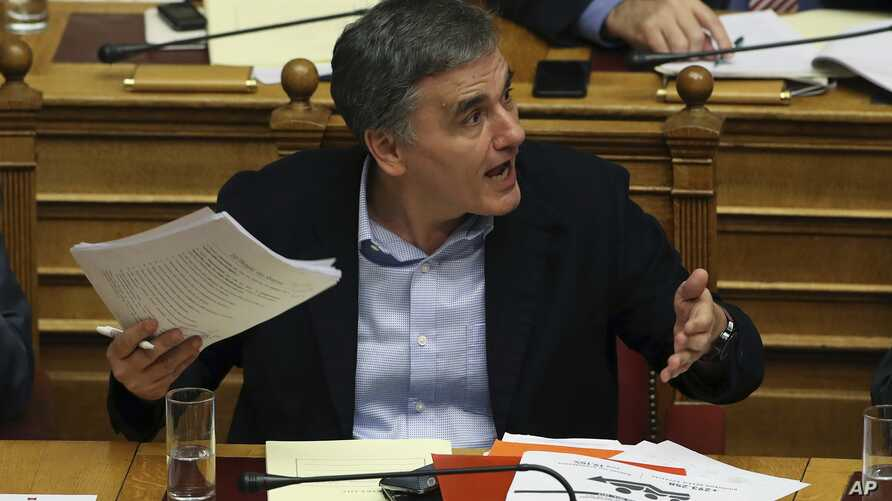 Greece's Finance Minister Euclid Tsakalotos reacts during a parliamentary debate in Athens, Dec. 19, 2017. Greek lawmakers later voted to approve the country's 2018 budget, which includes further austerity measures beyond the official end of Greece's
