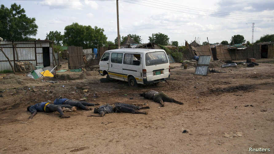 FILE - Slain bodies of civilians killed in renewed attacks lie along a road in Bentiu, Unity state of South Sudan.