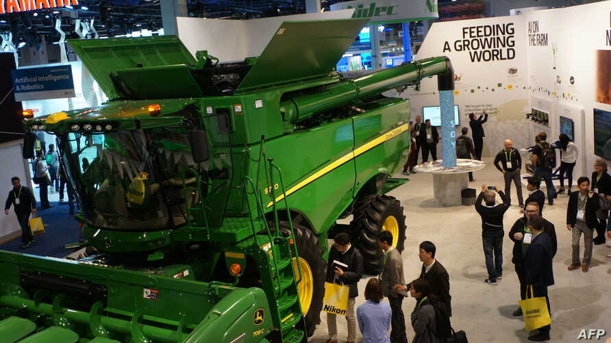 "Farm equipment maker John Deere made its debut at the Consumer Electronics Show, Jan. 9, 2019, in Las Vegas with a connected combine harvester, described as an ""intelligent factory on wheels."" It uses GPS, artificial intelligence and sensor technolog"