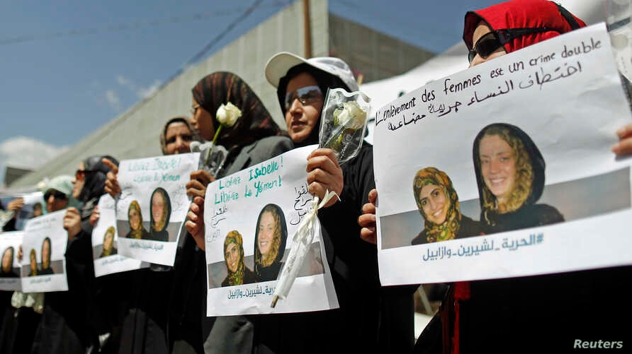 Women hold posters of Frenchwoman, Isabelle Prime (R) and her Yemeni translator Shereen Makawi, during a protest to demand their release, in San'aa, Yemen, March 9, 2015.