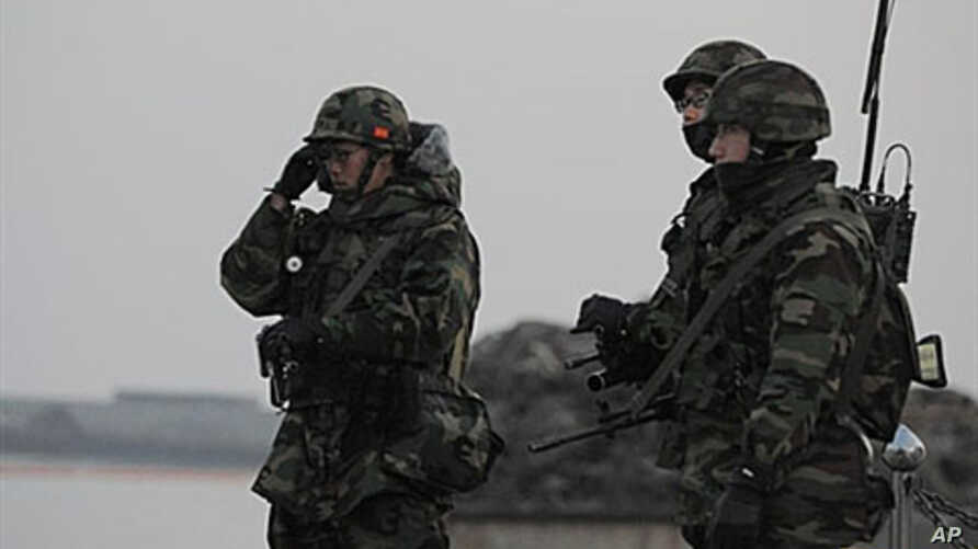 South Korean marines patrol at the South Korea-controlled island of Yeonpyeong near the disputed waters of the Yellow Sea, 22 Dec 2010