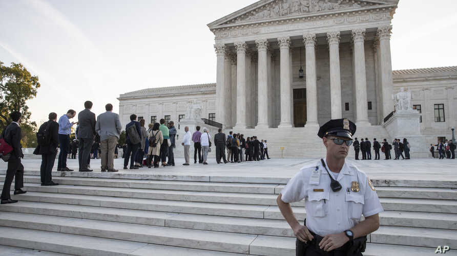 People line up at the Supreme Court on the first day of the new term, on Capitol Hill in Washington, Oct. 1, 2018.