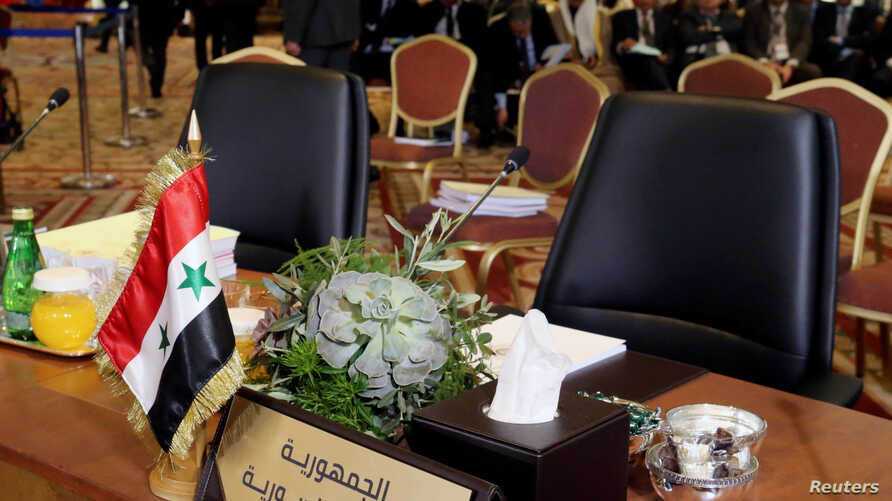 The empty seat of Syria is seen during a pre Arab Economic and Social Development summit meeting in Beirut, Lebanon January 18, 2019.