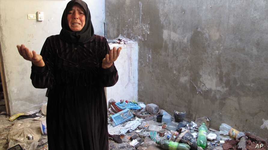 A resident of Bustan al-Qusr complained about trash left in her home by Syrian soldiers who took over her house during summer fighting in Aleppo, August 5, 2012.