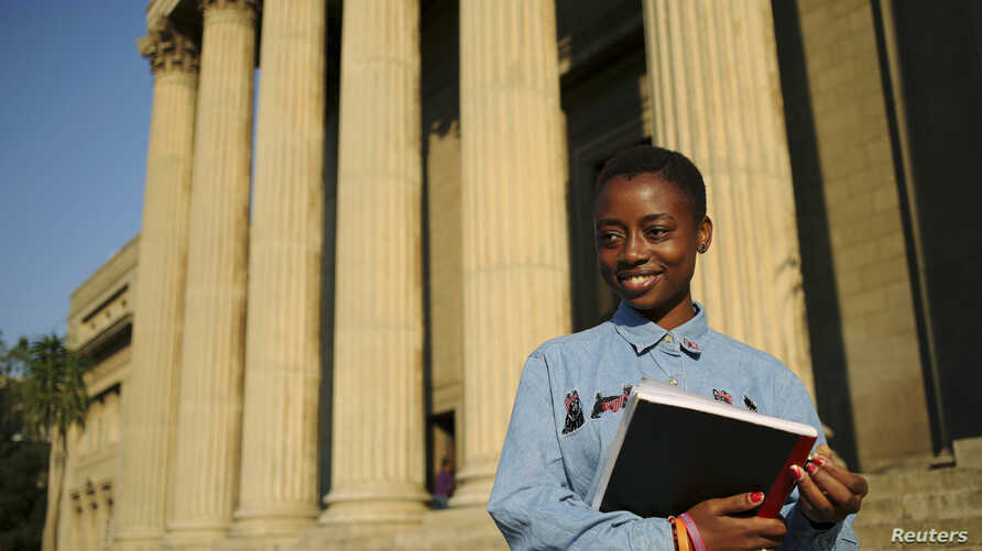 FILE - Second-year civil engineering student and first-time voter Nkululeko Simelane poses for a picture at Wits University in Johannesburg, April 22, 2014.