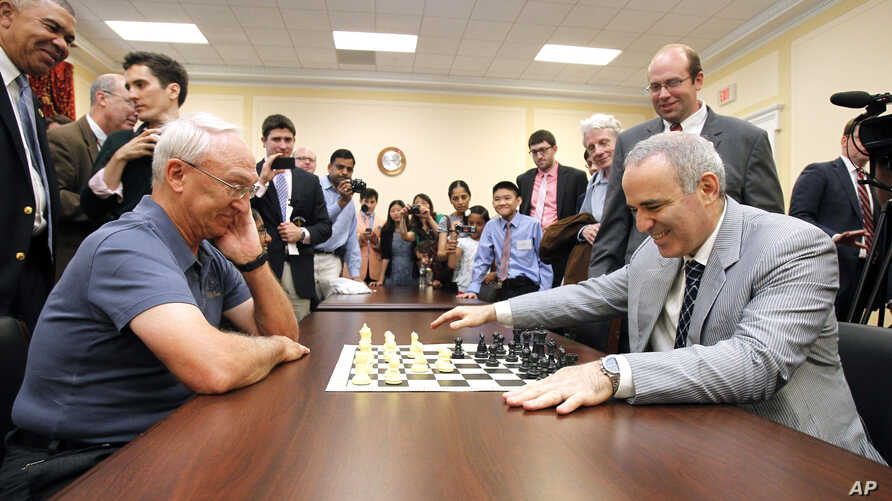 World Chess Champion Garry Kasparov, right, and Rex Sinquefield, founder and president of the Board of Directors of the St. Louis Chess Club, kick-off the first-ever Congressional Chess Match at the Rayburn House Office Building in Washington, D.C.,