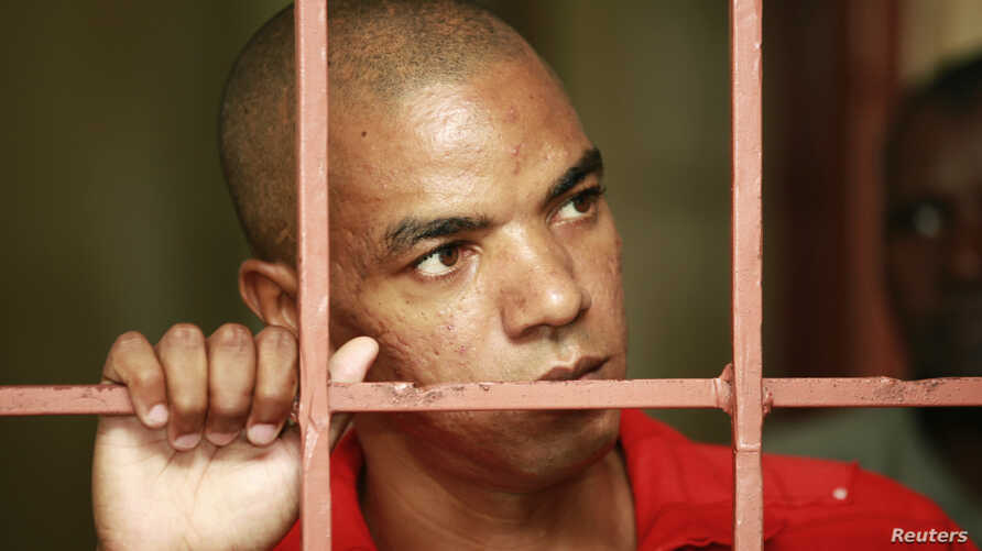 Jermaine John Grant, a British citizen, waits in a cell to attend his ongoing trial at the Shanzu law courts near the coastal city of Mombasa, Kenya, Feb. 17, 2014.