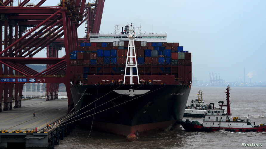 A cargo ship is anchored at a port in Zhoushan, Zhejiang province, Feb. 14, 2016. China's exports fell 11.2 percent in January from a year earlier and imports tumbled 18.8 percent.