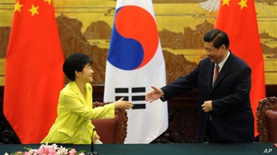 South Korean President Park Geun-hye, left, and Chinese President Xi Jinping, Great Hall of the People, Beijing, June 27, 2013.