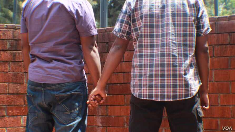 FILE - A Kenyan gay couple is seen holding hands. Homosexuality is illegal in at least 36 African countries, including Kenya. Penalties include prison and fines. (Photo - Rael Ombuor/VOA)