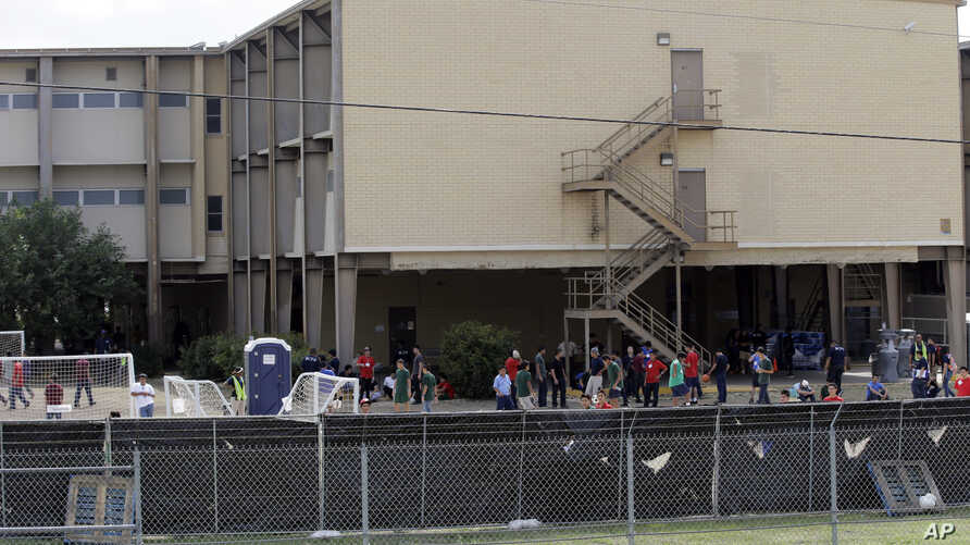 FILE - A temporary shelter for unaccompanied minors who have entered the country illegally is seen at Lackland Air Force Base, in San Antonio, June 23, 2014.