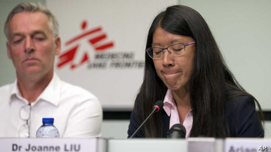 International President for Doctors Without Borders, Joanne Liu, right, pauses before speaking at the International Press Center in Brussels, Sept. 7, 2017. The head of medical aid group Doctors Without Borders says European governments are paying fo