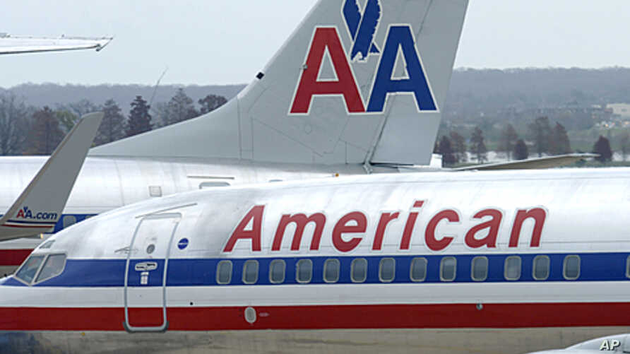 American Airlines planes sit at a gate at Washington's Ronald Reagan National Airport. American Airlines and its parent company are filing for bankruptcy protection as they try to cut costs and unload massive debt built up by years of high fuel price