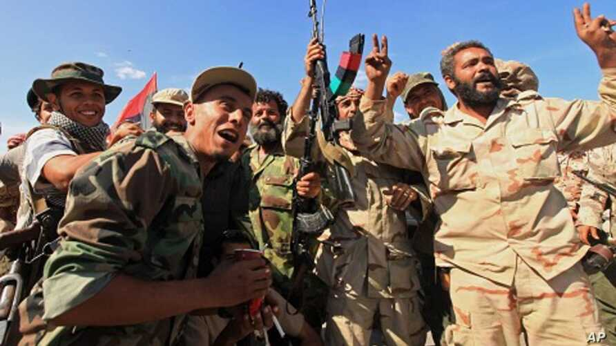 Anti-Gaddafi fighters celebrated the fall of Sirte October 20, 2011.