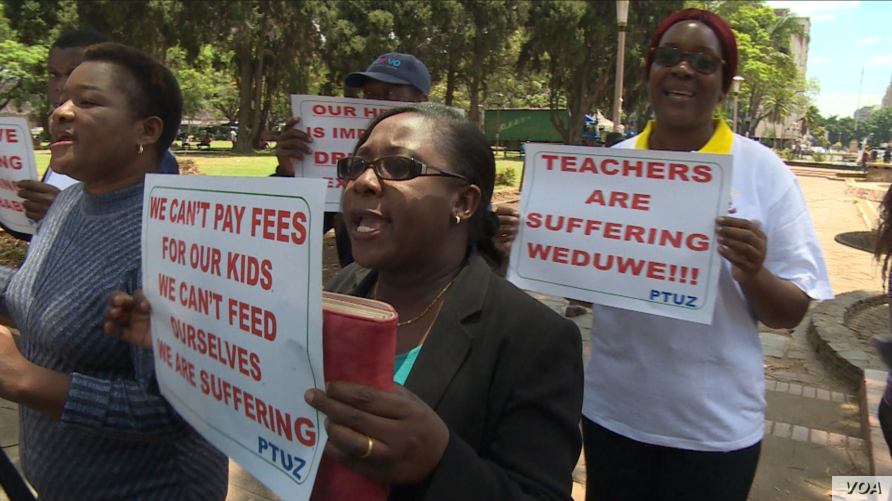 Teachers demanding to be paid in U.S. dollars take to the streets in Harare, Zimbabwe, Nov. 9, 2018.