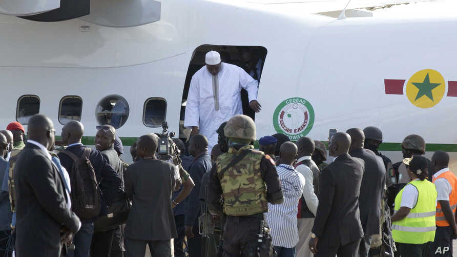 Gambian President Adama Barrow, disembarks a plane as he arrives at Banjul airport in Gambia, Thursday Jan. 26, 2017, after flying in from Dakar, Senegal.