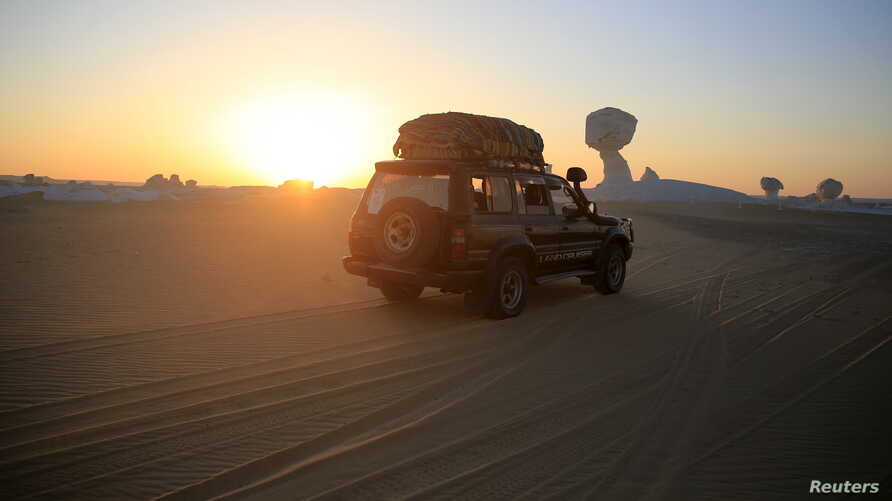 FILE  - A four-wheel drive car crosses the Egyptian western desert and the Bahariya Oasis, southwest of Cairo in this picture taken May 15, 2015.
