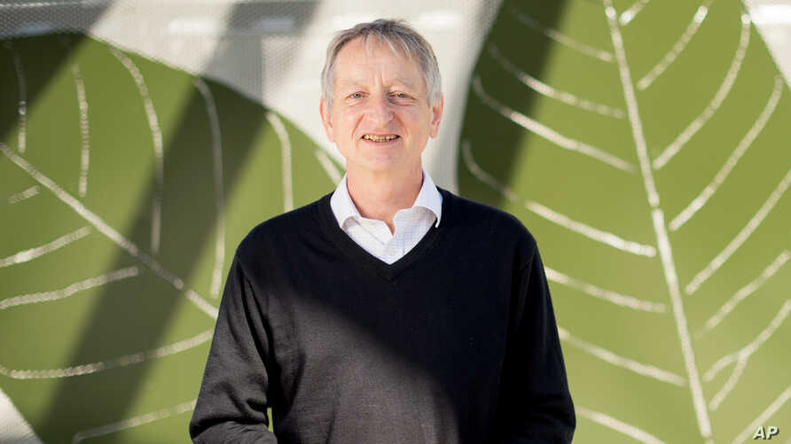 FILE - Computer scientist Geoffrey Hinton, who studies neural networks used in artificial intelligence applications, poses at Google's Mountain View, Calif, headquarters.