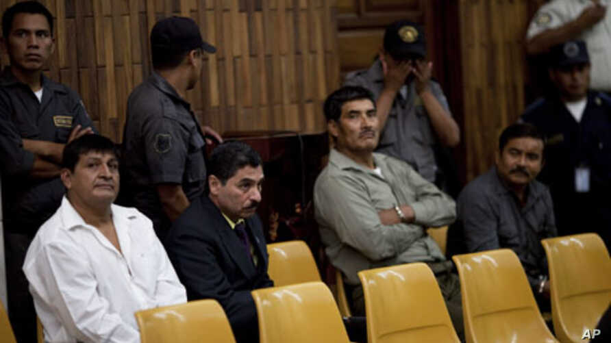 From left to right, Daniel Martinez, Carlos Antonio Carias, Manuel Pop Sun, and Reyes Collin Gualip, sit in the courtroom during the first day of their trial in Guatemala City, July 25, 2011