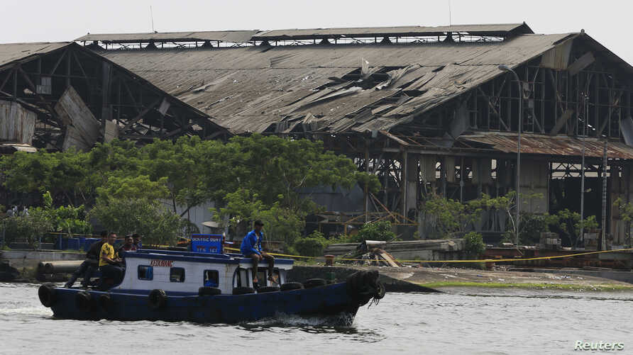 The facade of a Navy ammunition warehouse, damaged by an explosion, at Pondok Dayung island in Jakarta, March 5, 2014.