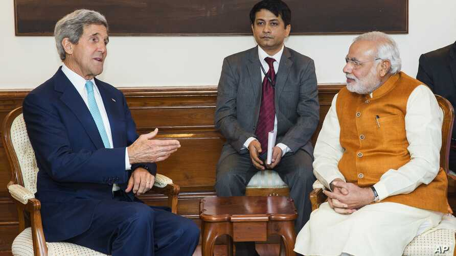 U.S. Secretary of State John Kerry speaks with Indian Prime Minister Narendra Modi at the latter's residence in New Delhi, India,  Aug. 1, 2014.