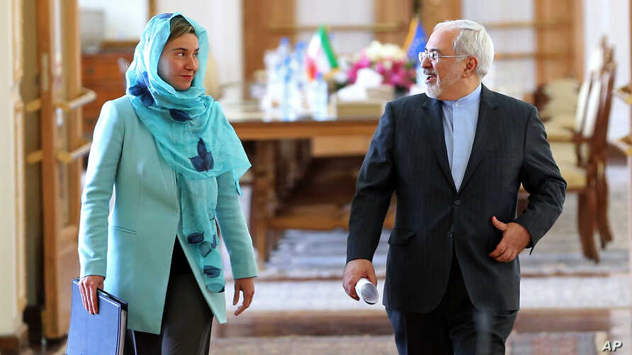 Iranian Foreign Minister Mohammad Javad Zarif and European Union foreign policy chief Federica Mogherini arrive to attend a press briefing after their meeting in Tehran, Iran, April 16, 2016.