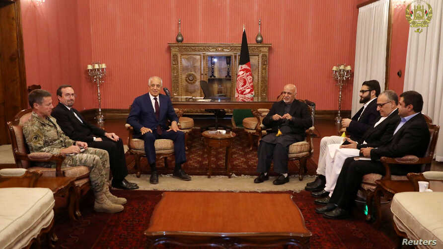 FILE - Afghanistan's President Ashraf Ghani (R) and U.S. special envoy for peace in Afghanistan, Zalmay Khalilzad (L), meet in Kabul, Afghanistan, Nov. 10, 2018.  (Presidential Palace/Handout via Reuters)