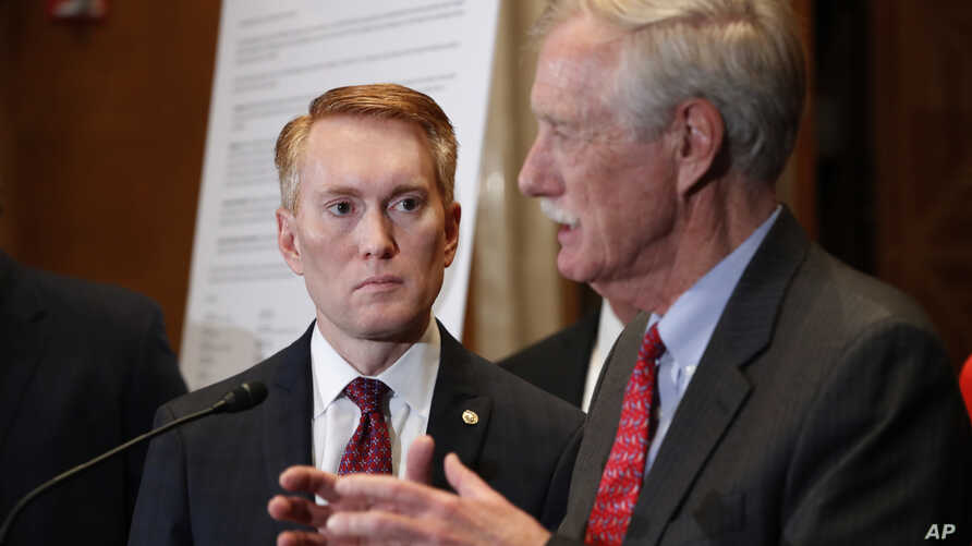 Sen. James Lankford, R-Okla., listens as Sen. Angus King, I-Maine, speaks about immigration and the Deferred Action for Childhood Arrivals (DACA) program, Feb. 7, 2018, on Capitol Hill in Washington.