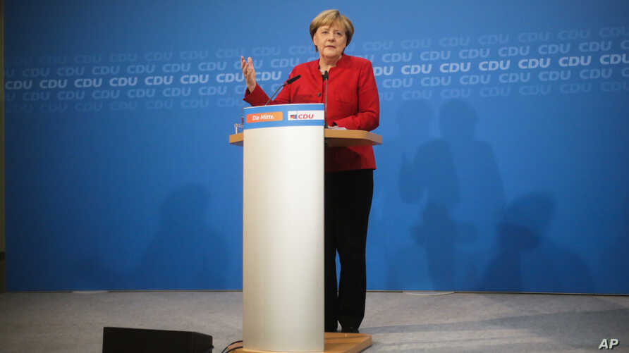 German Chancellor Angela Merkel addresses journalists at a news conference to announce that she will run again for the chancellorship in next year's general elections, at the Christian Democratic Union Party (CDU) headquarters in Berlin, Germany, Nov