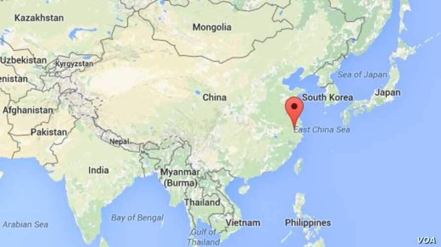 The red arrow shows Zhejiang province, China.
