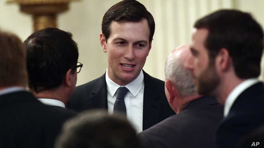 FILE - In this June 29, 2018, file photo, White House adviser Jared Kushner speaks with people as they wait for President Donald Trump to arrive in the East Room of the White House.