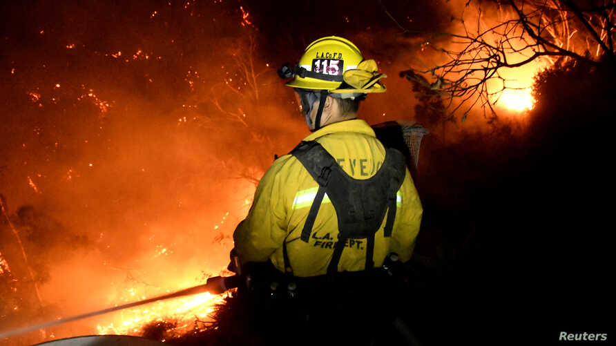 Firefighters battle the Thomas wildfire in the hills and canyons outside Montecito, California, Dec. 16, 2017.