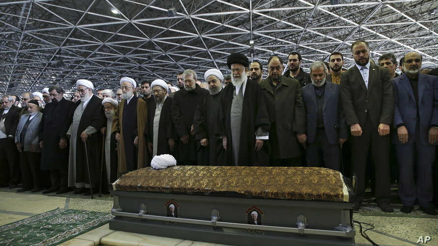 In this picture released by an official website of the office of the Iranian supreme leader, Supreme Leader Ayatollah Ali Khamenei, foreground center, leads a prayer over the casket of former President Akbar Hashemi Rafsanjani at the Tehran Universit