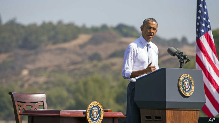 FILE - President Barack Obama speaks at Frank G. Bonelli Regional Park in San Dimas, Calif., as he designated the nearly 350,000 acres within the San Gabriel Mountains northeast of Los Angeles a national monument, Oct. 20, 2014. Obama is granting nat...