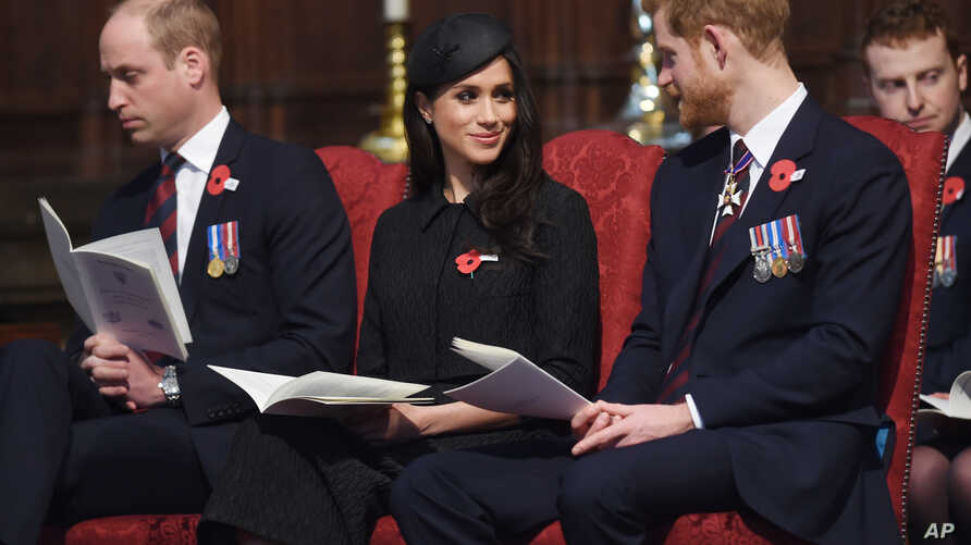 Britain's Prince William, left, Prince Harry and Meghan Markle attend a Service of Thanksgiving and Commemoration on ANZAC Day at Westminster Abbey in London, April 25, 2018.